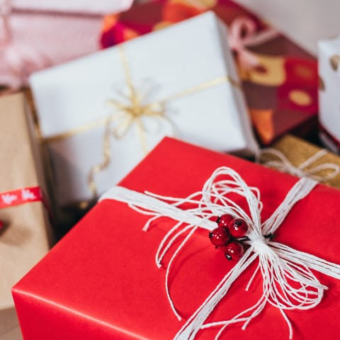 Image of gifts wrapped in brightly coloured paper